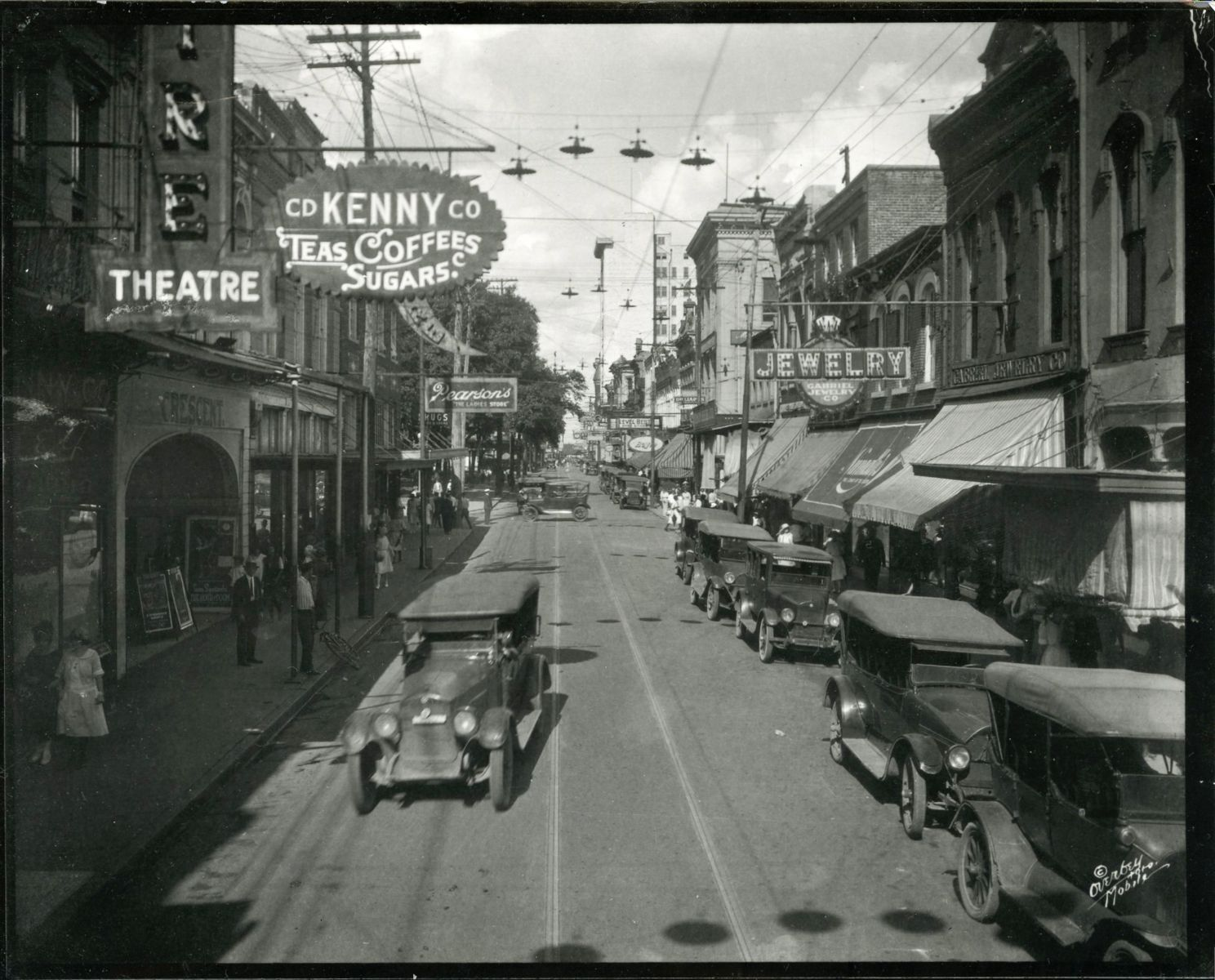 old street scene with early automobiles