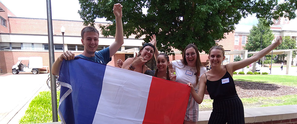 2018 Exchange Students taking a picture with the French flag