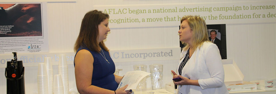 A CLA student engaged with the HR representative at AFLAC.