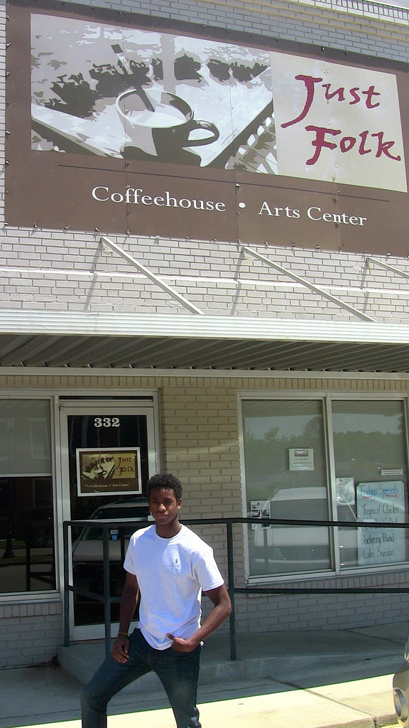 Jelani outside coffeehouse and arts center