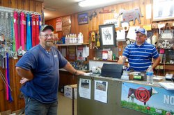 An employee and customer in Rusty's Feed & Seed
