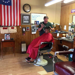 Barber cutting client's hair at Collinsville Barber Shop