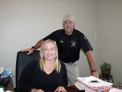 Rebecca Farmer left and Sheriff David Cofield right