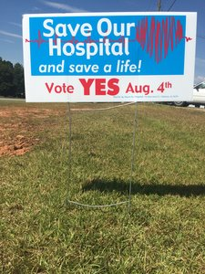 Sign in yard saying to vote yes