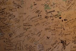 Wall inside the Rabbit Hole where people have signed their names