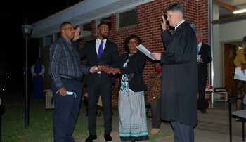Messiah Williams-Cole is sworn in by Lee County Judge Mike Fellows