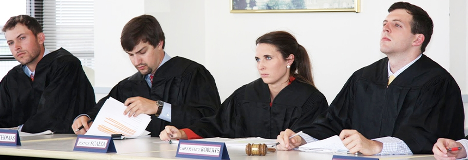 Student justices listen to oral arguments at moot court