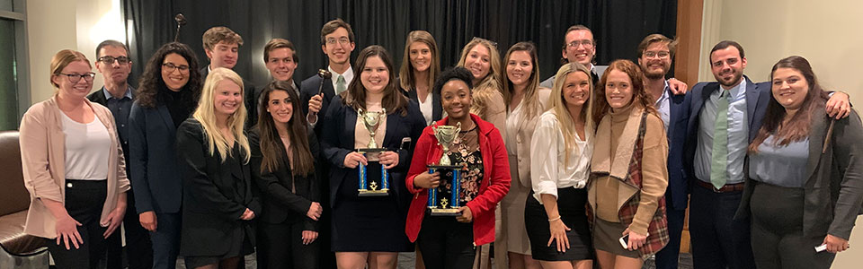 mock trial students standing with 3rd place trophies at MTSU