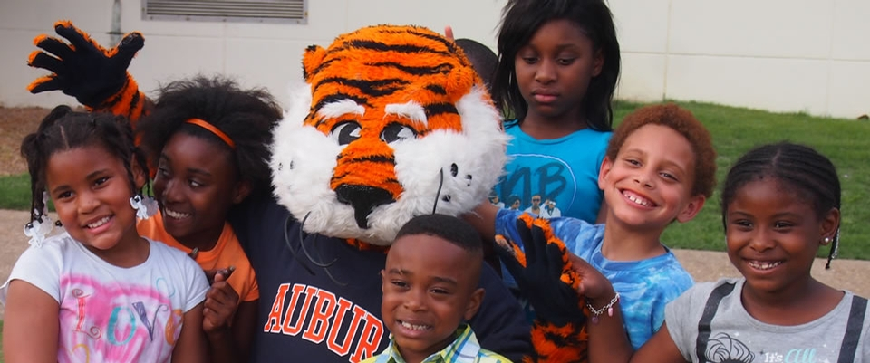 six children with Aubie Tiger
